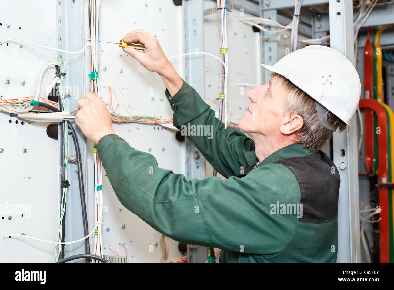 People Electrical Wiring Not Lossing Diagram Circuit For A Contractor Mature Electrician Working In White Hard Hat With Cables And Wires Rh Alamy Com Breaker Outlet