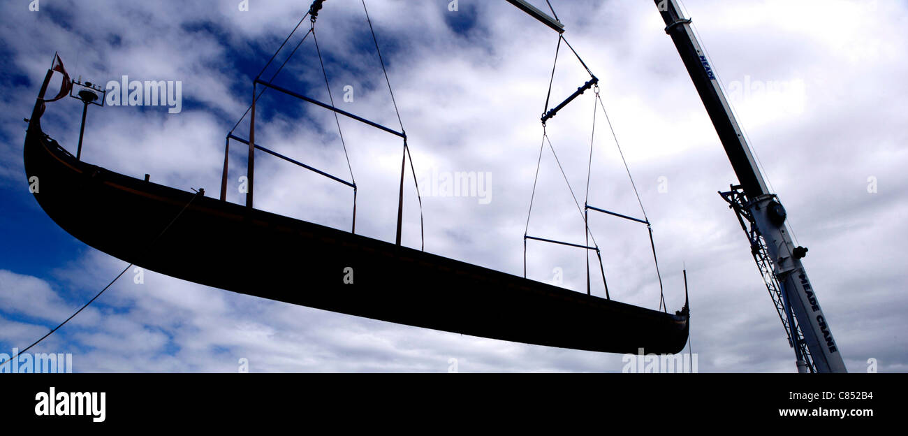 Lift of the viking ship 'Sea Stallion' at the National Museum of Ireland against the blue sky in silhouette - Stock Image