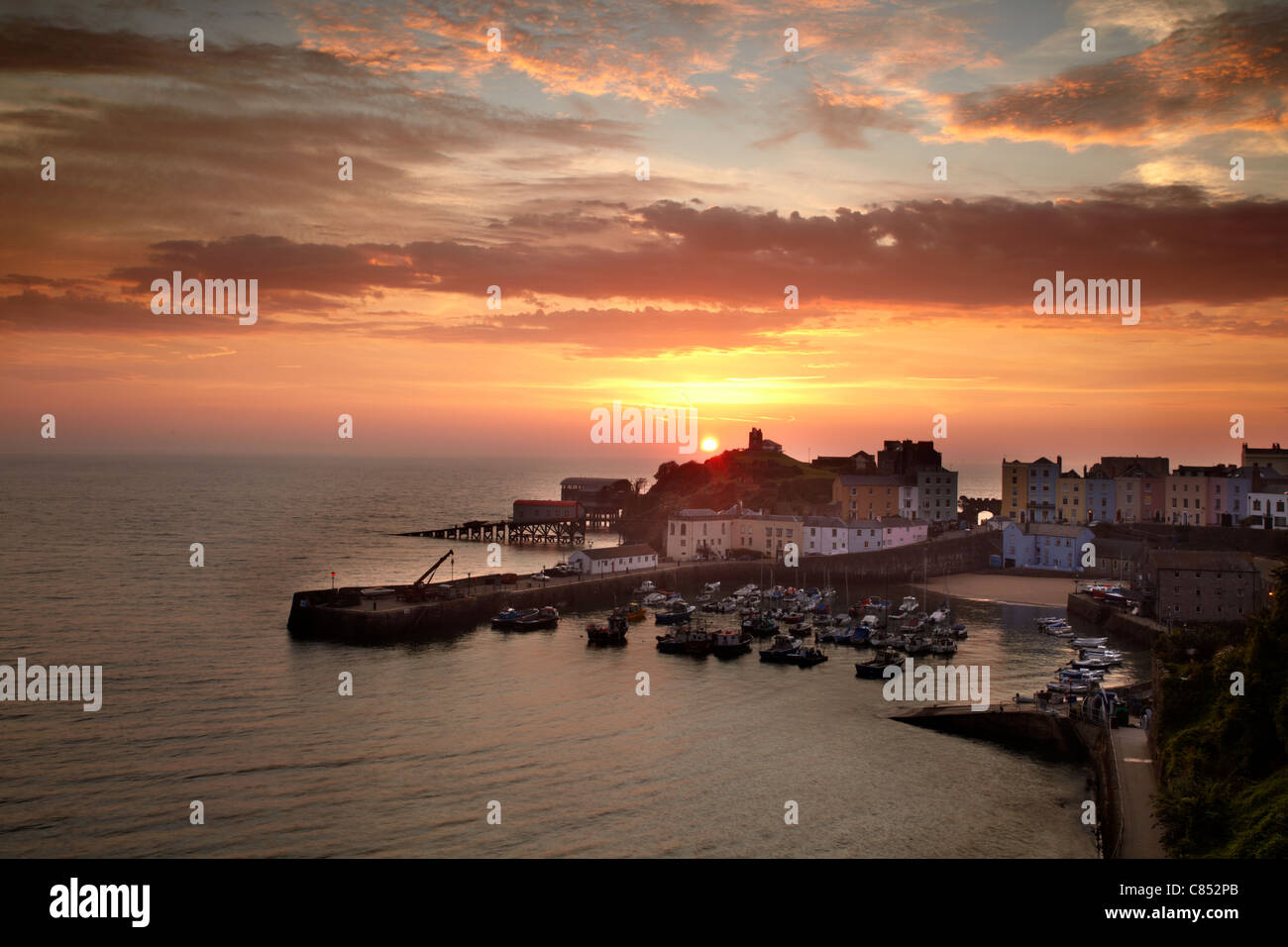 Tenby harbour, Pembrokeshire, at sunrise. - Stock Image