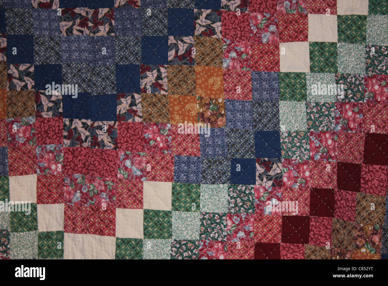 Colorful Amish Quilt in a square pattern - Stock Image