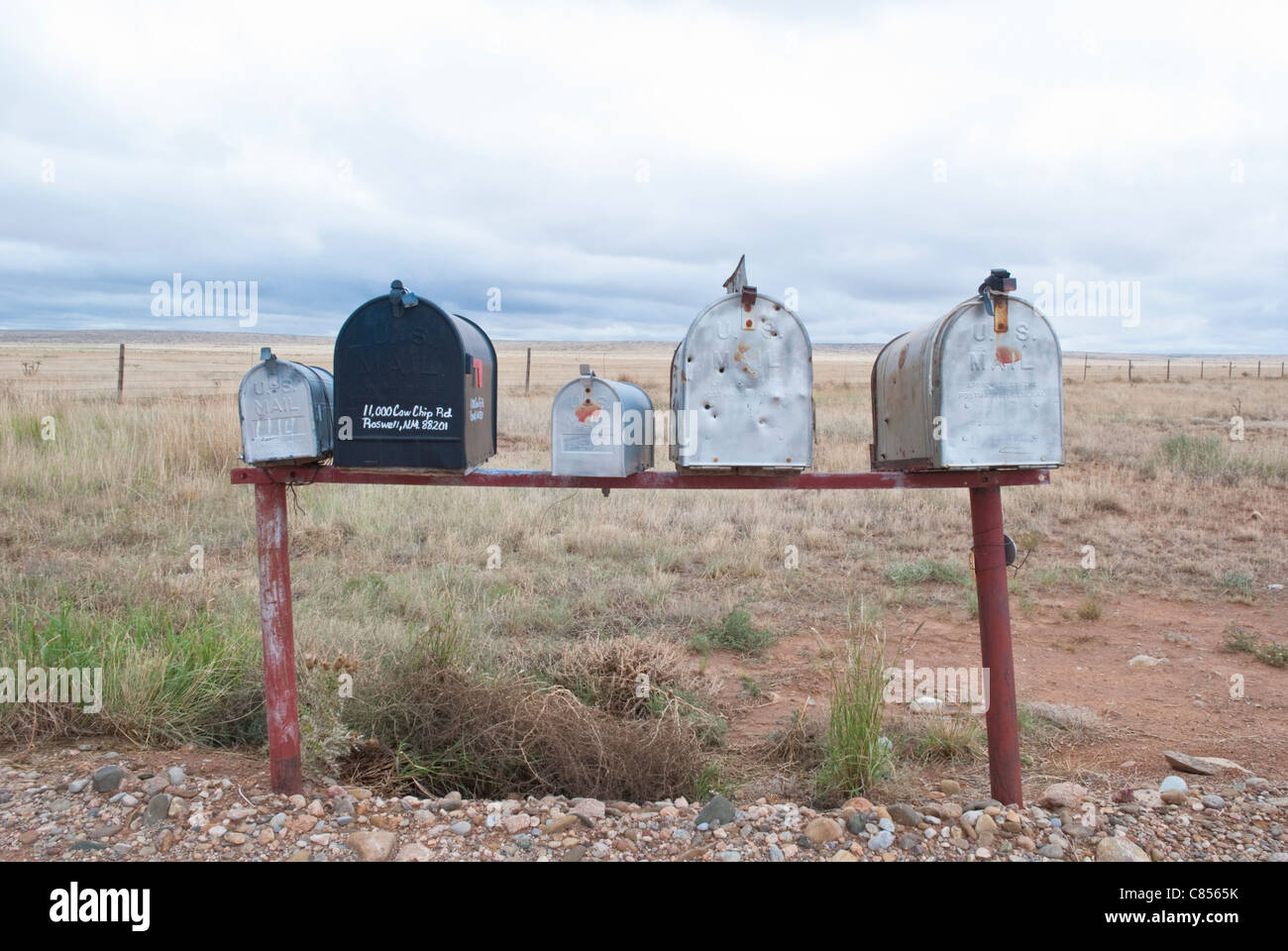 Lonely mailboxes sit at the end of Cow Chip Road in rural New Mexico. - Stock Image