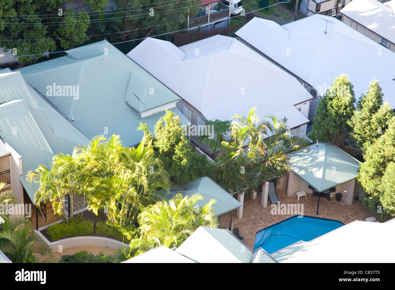 looking down on residential roofs and swimming pool,brisbane,queensland,australia - Stock Image