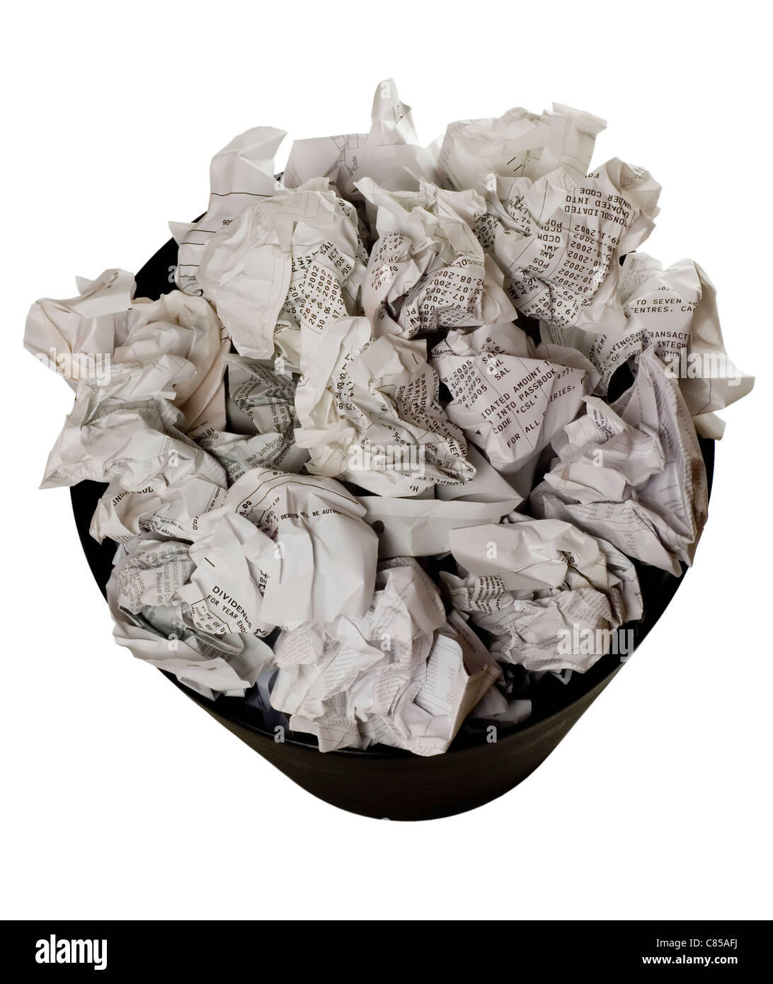 Wastepaper basket full of crumpled paper isolated on white background - Stock Image
