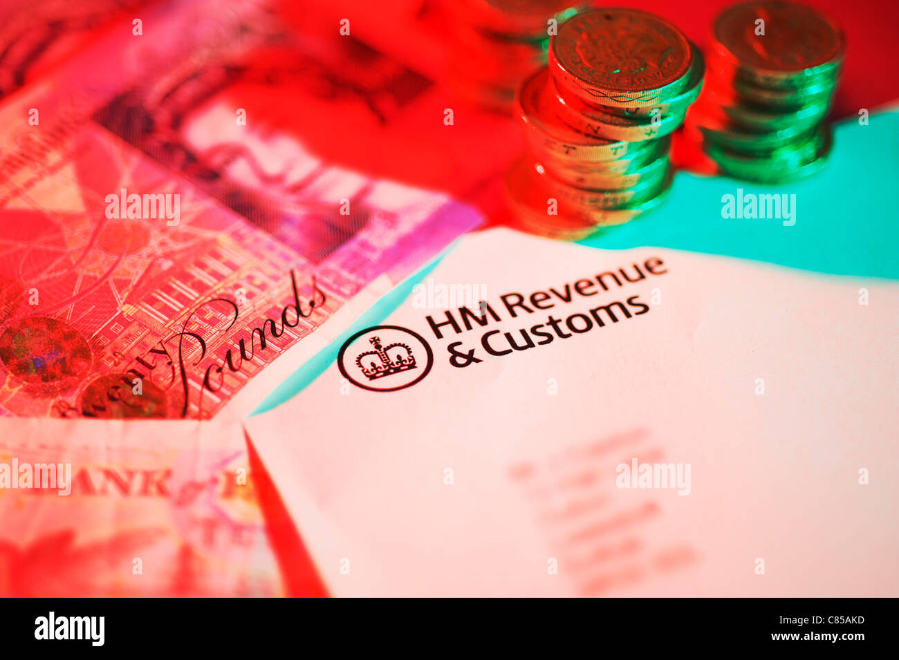 HM Revenue and Customs final demand letter with sterling pound coins and twenty pound notes - Stock Image