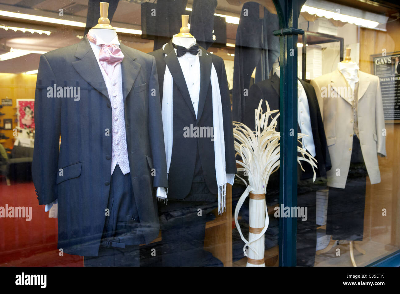 4e3c1259a7fd1 mens suits in the window of a dress hire shop in ireland Stock Photo ...