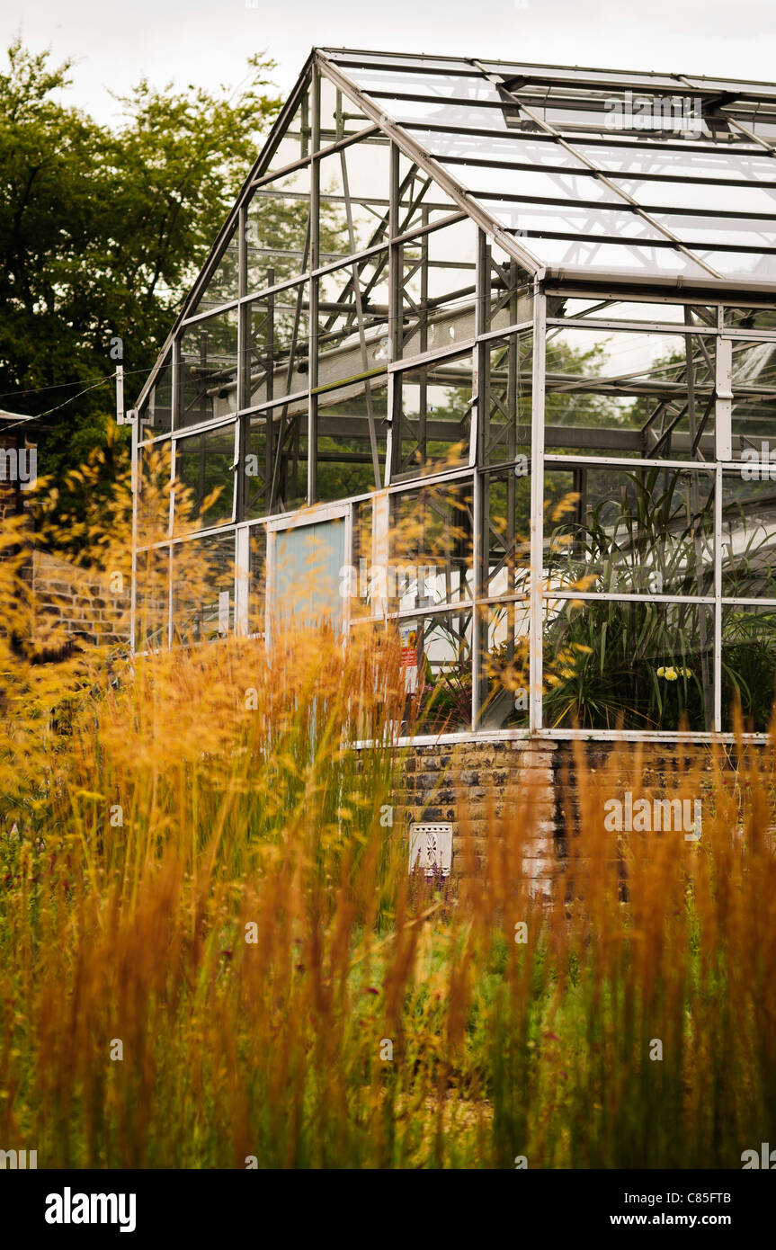 A large greenhouse run by a local gardeners club and can be found at Crows Nest Park near Dewsbury - Stock Image