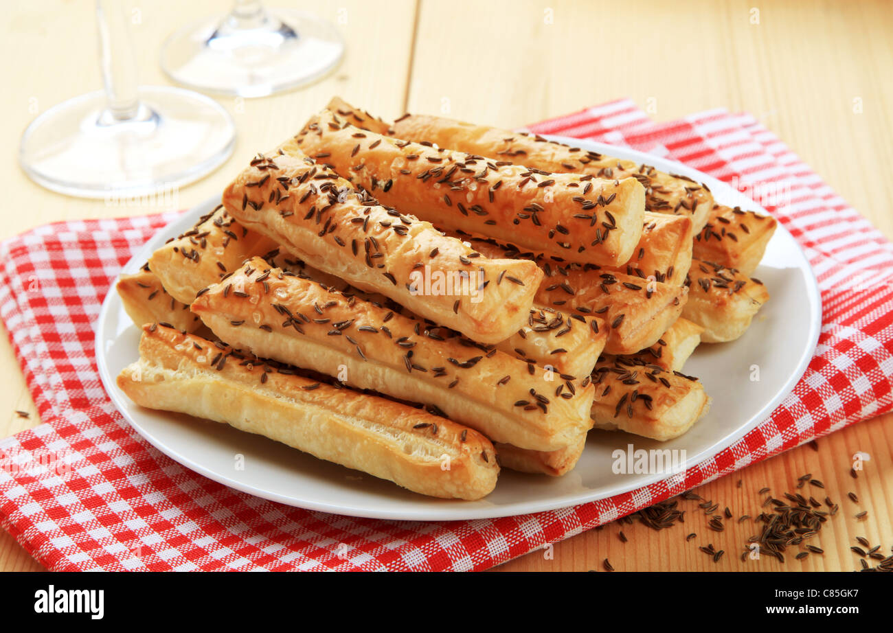 Crisp snacks with caraway seeds on top - Stock Image