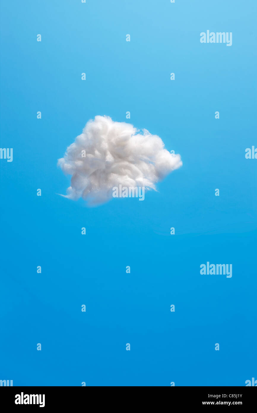 Cotton wool clouds against blue background - Stock Image
