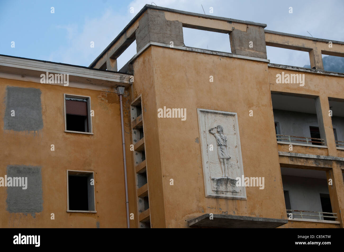 Tirana. Old abandoned youth hostel in art deco style with fresco of girl scout left over from Enver Hoxha period - Stock Image