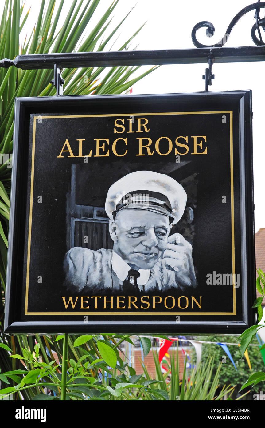 Close up of hanging sign depicting Sir Alec Rose. - Stock Image