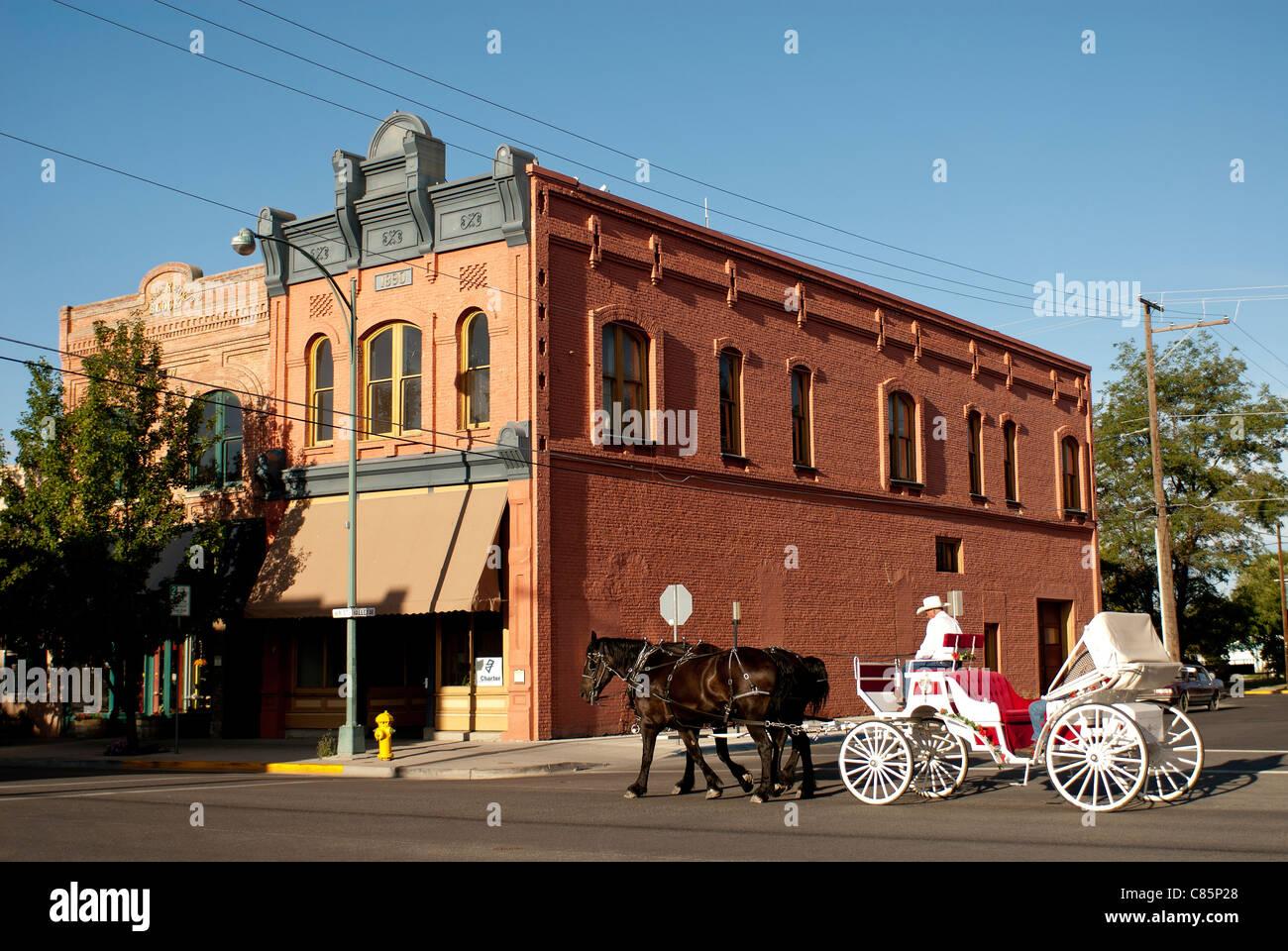 Horse carriage on Main Street; Baker City; Oregon - Stock Image
