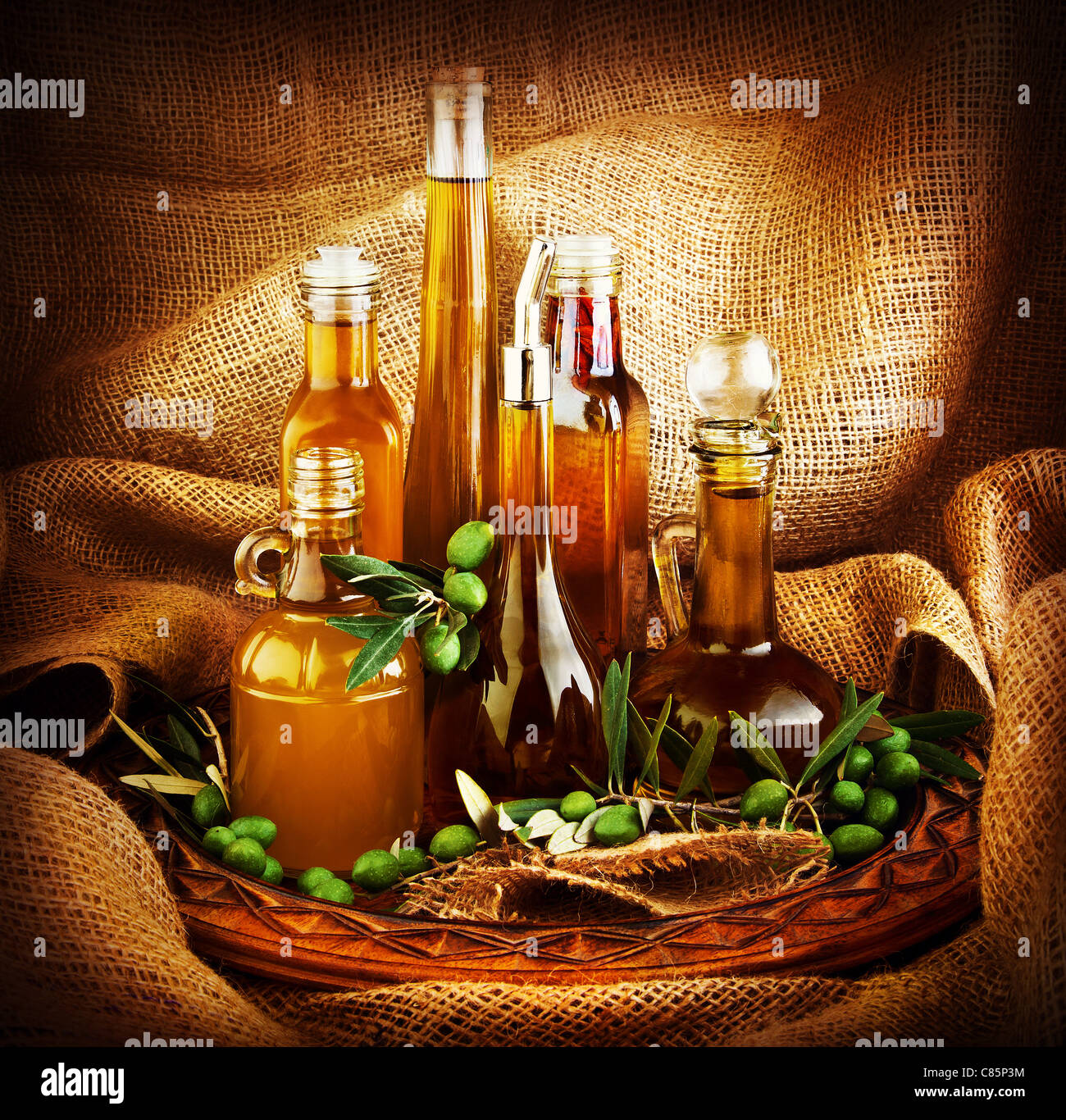 Different salad dressings, olive oils, vinegars, seasoning, condiment, sauces, sauces, dips..etc. dark still life - Stock Image