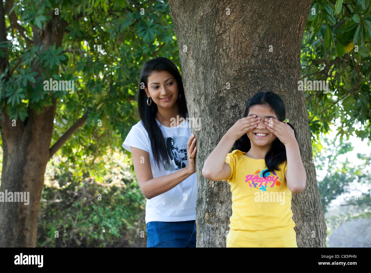 Mother and daughter playing hide and seek - Stock Image