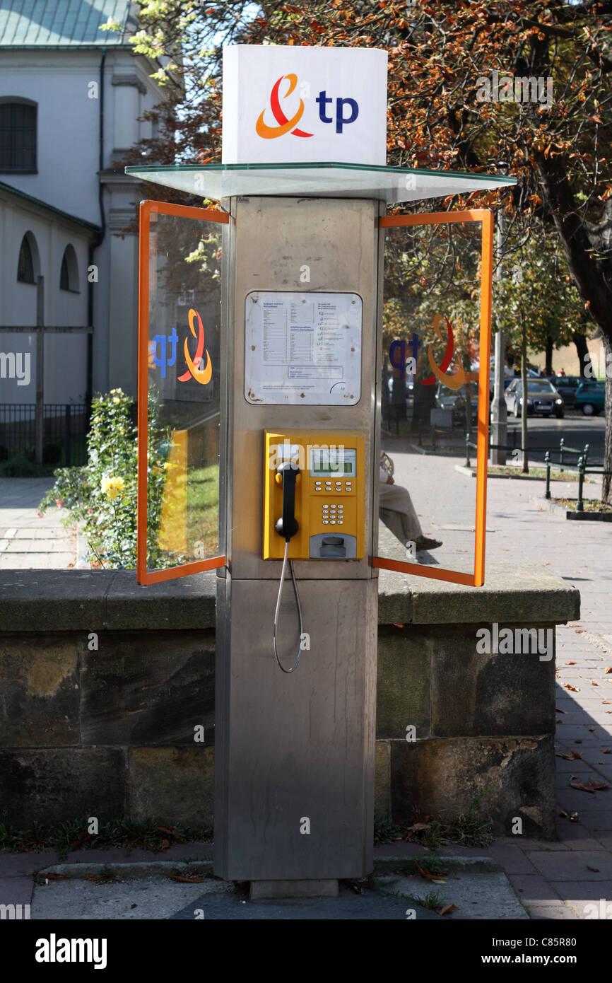 Public telephone kiosk, Krakow, Poland - Stock Image
