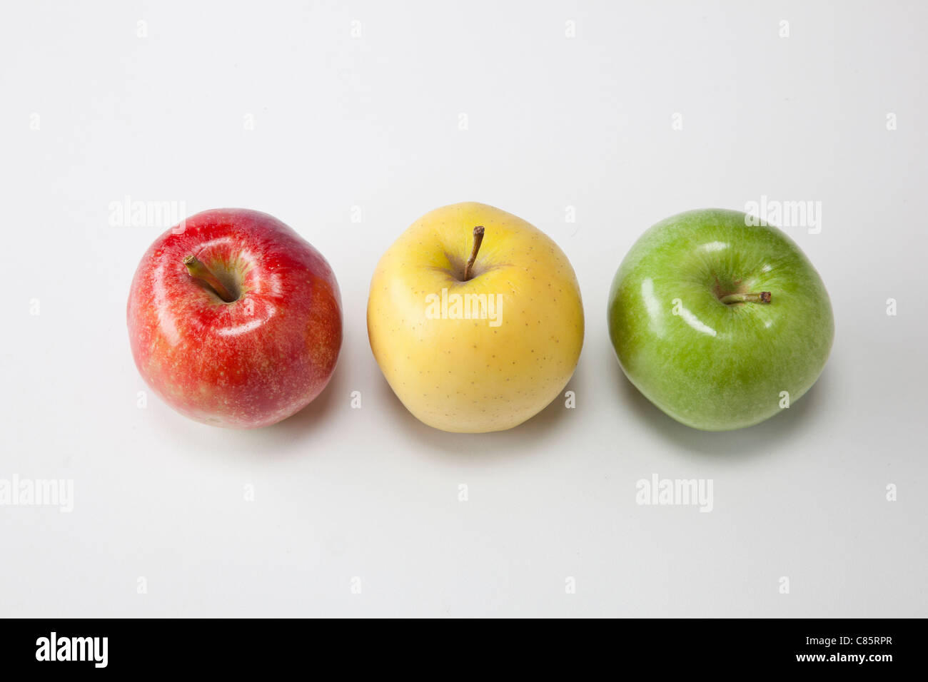 three different types of apples on white - Stock Image