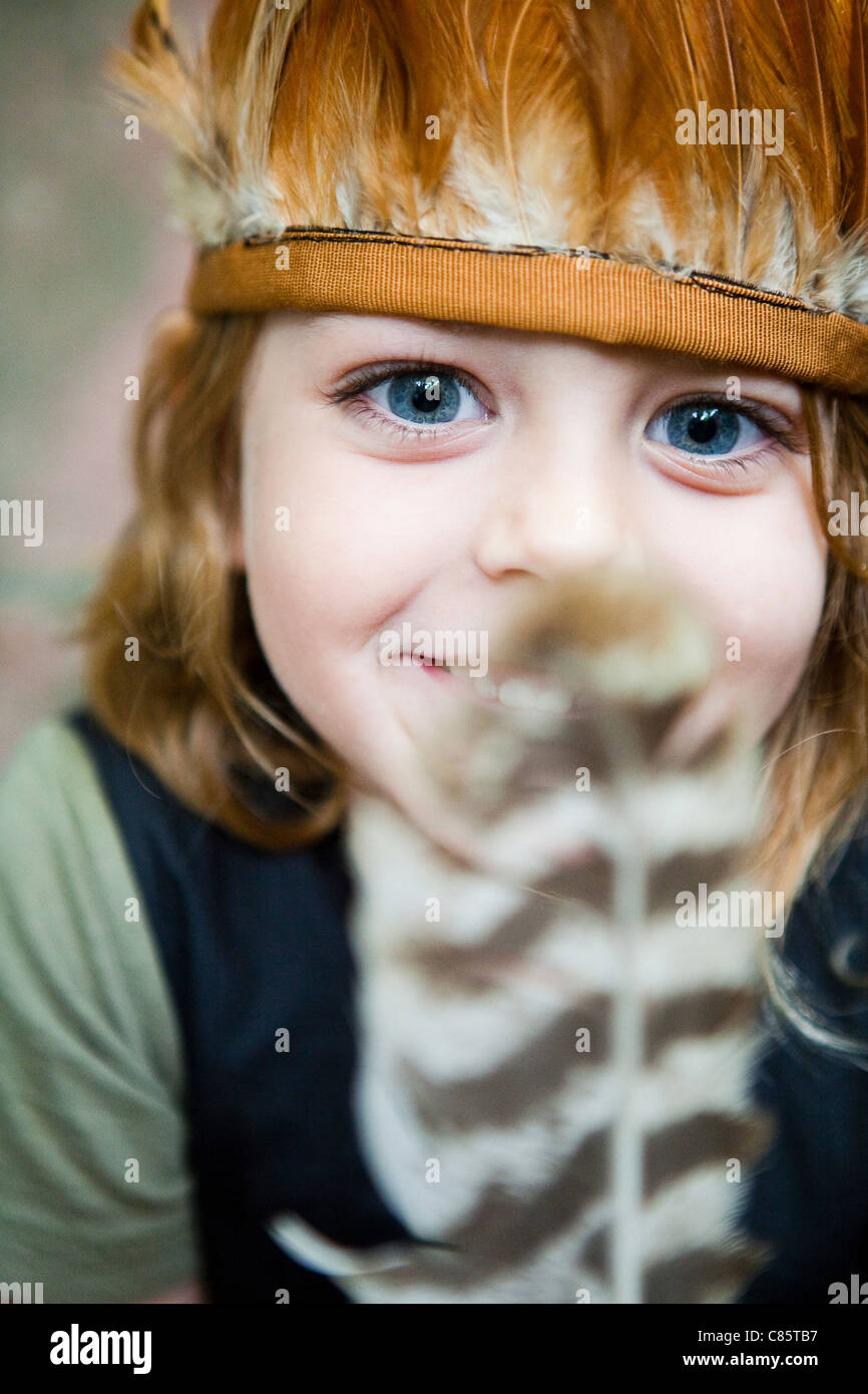 Little boy in feather headdress Stock Photo