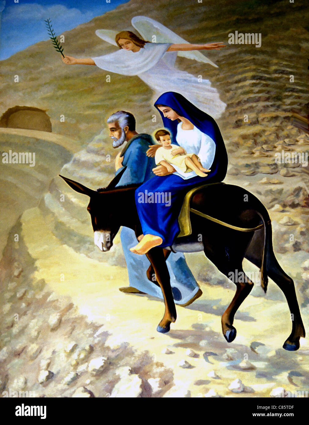 Mural of the travels of the Holy Family in Egypt, Joseph, Mary riding a donkey and Jesus - Stock Image