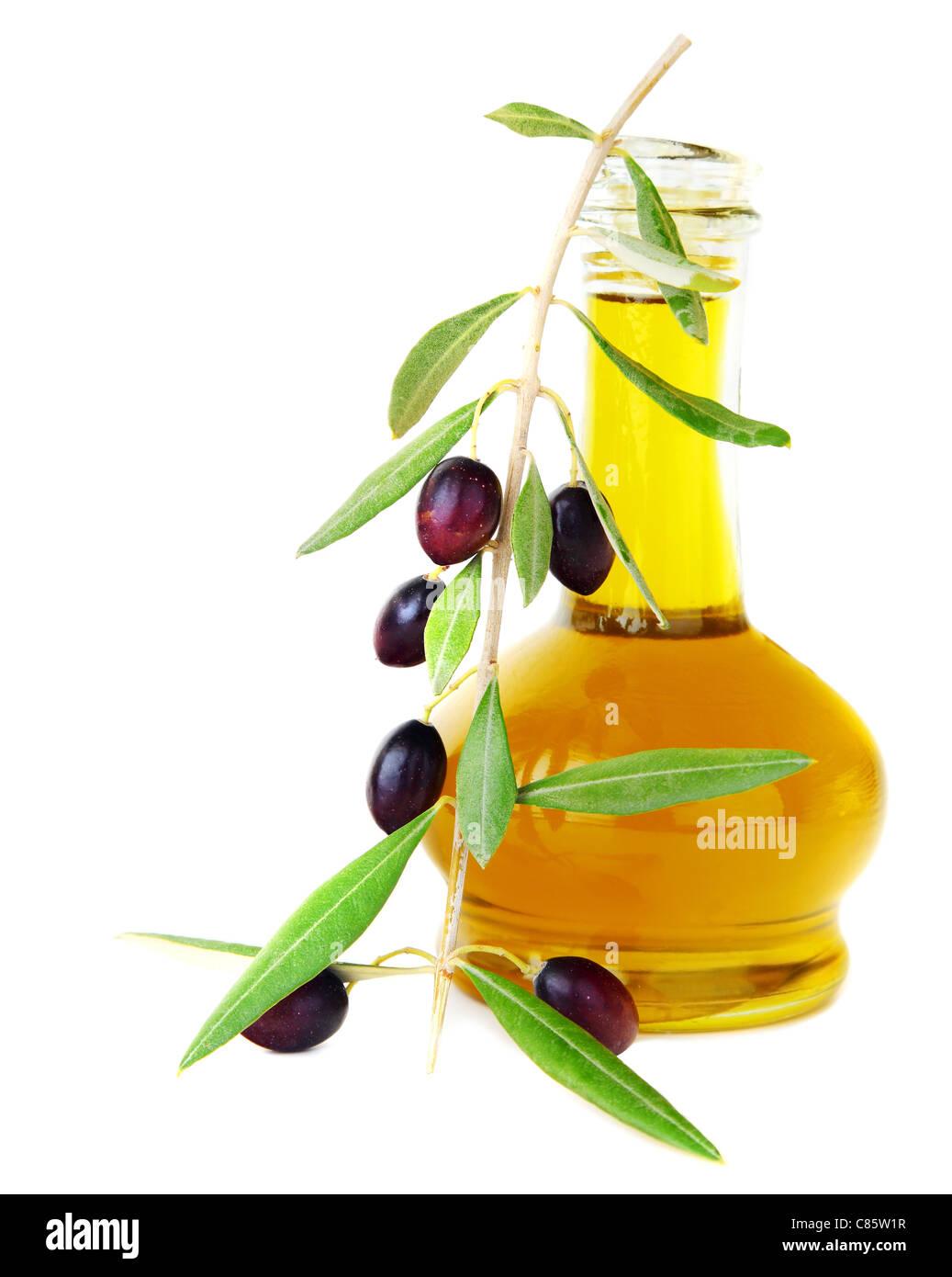 Fresh black olives & olive oil isolated on white background - Stock Image