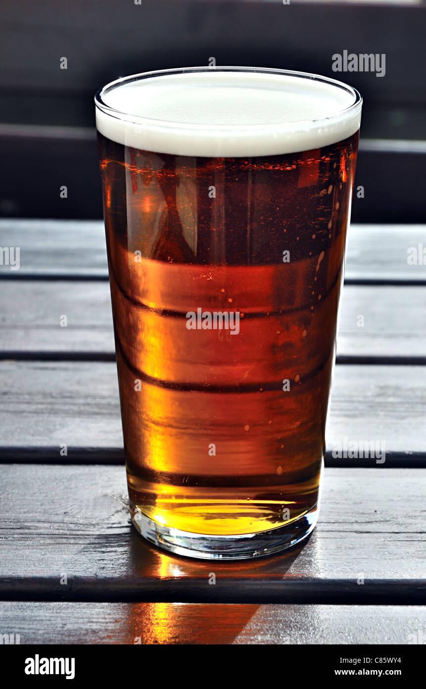 Pint of Bluebird Ale - Stock Image