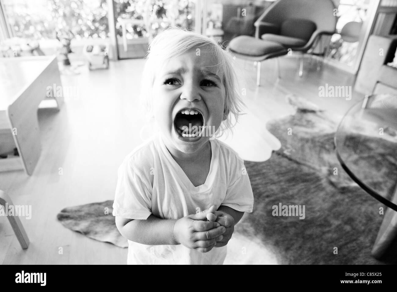Little boy screaming - Stock Image