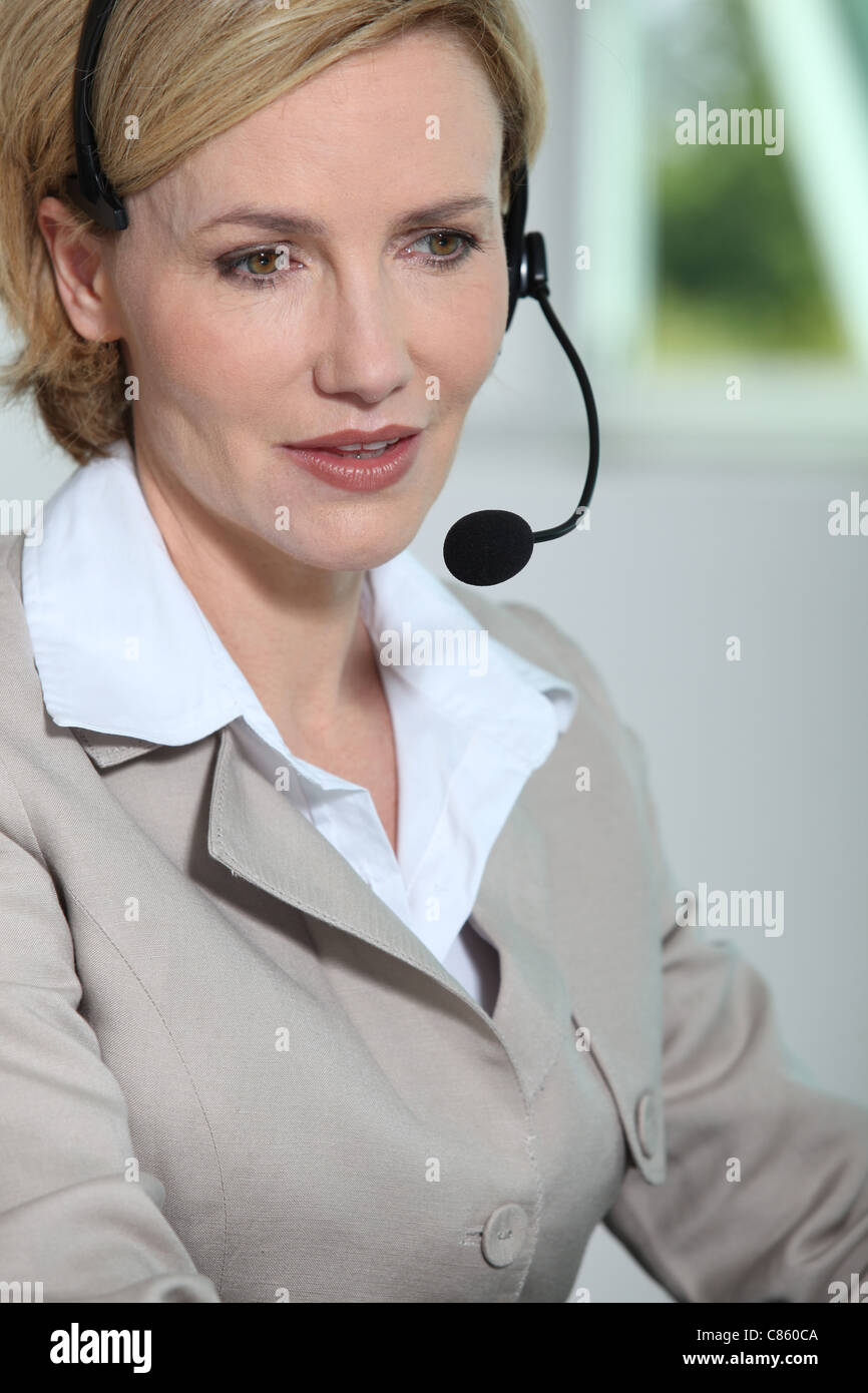 Woman with headset. - Stock Image