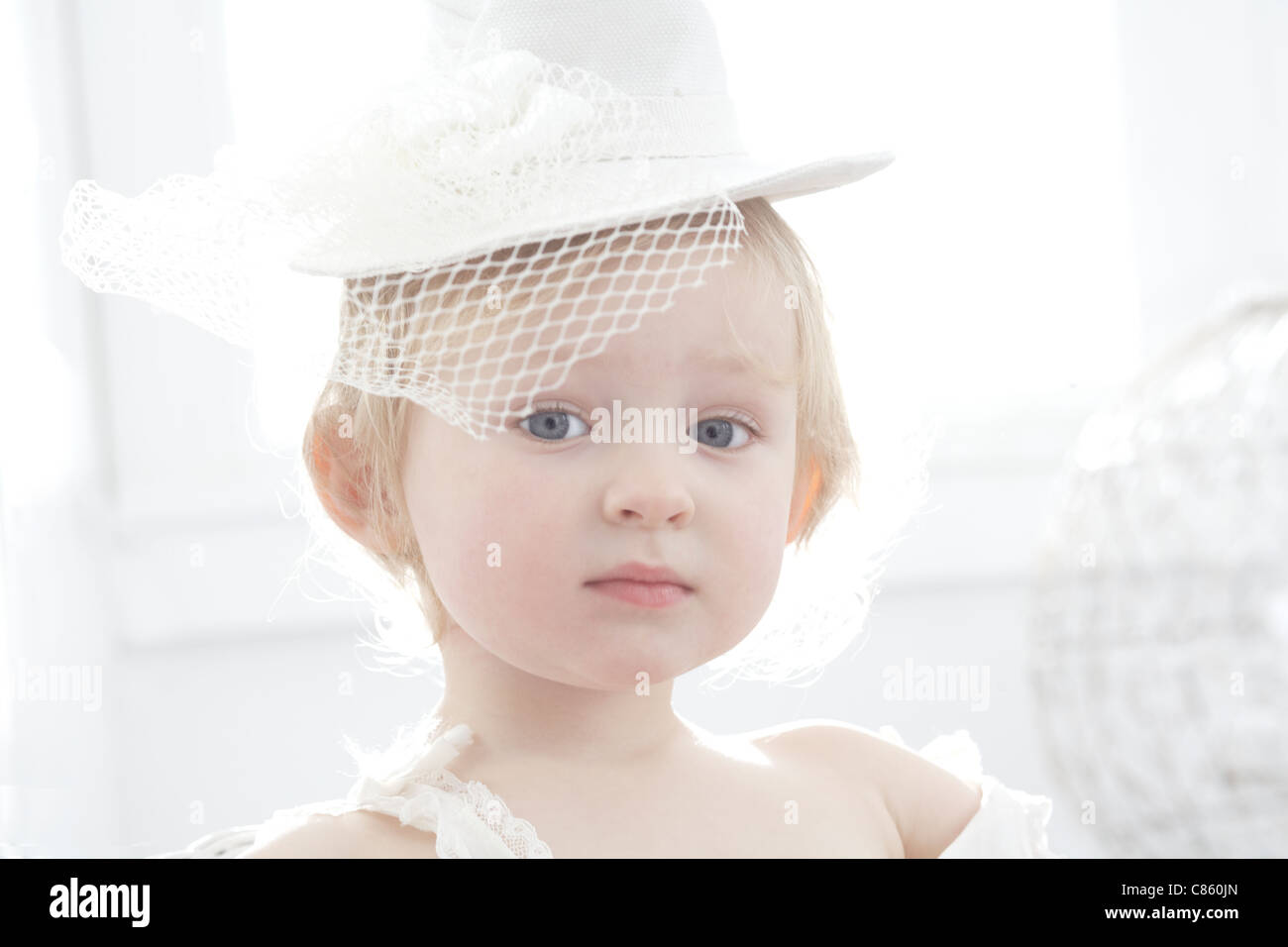 Little girl wearing a fancy hat - Stock Image