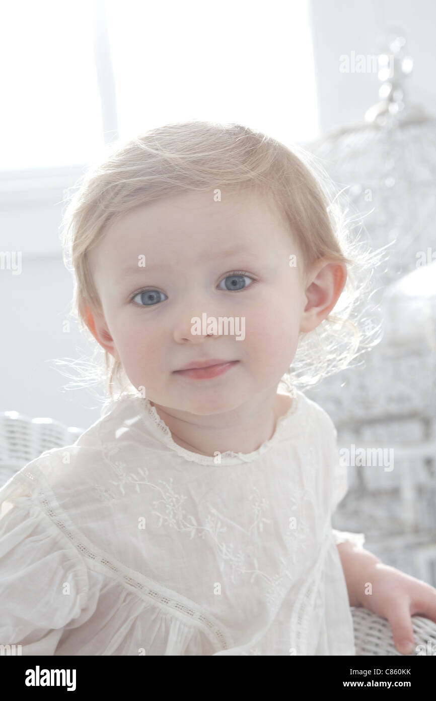 Angelic little girl in white dress - Stock Image