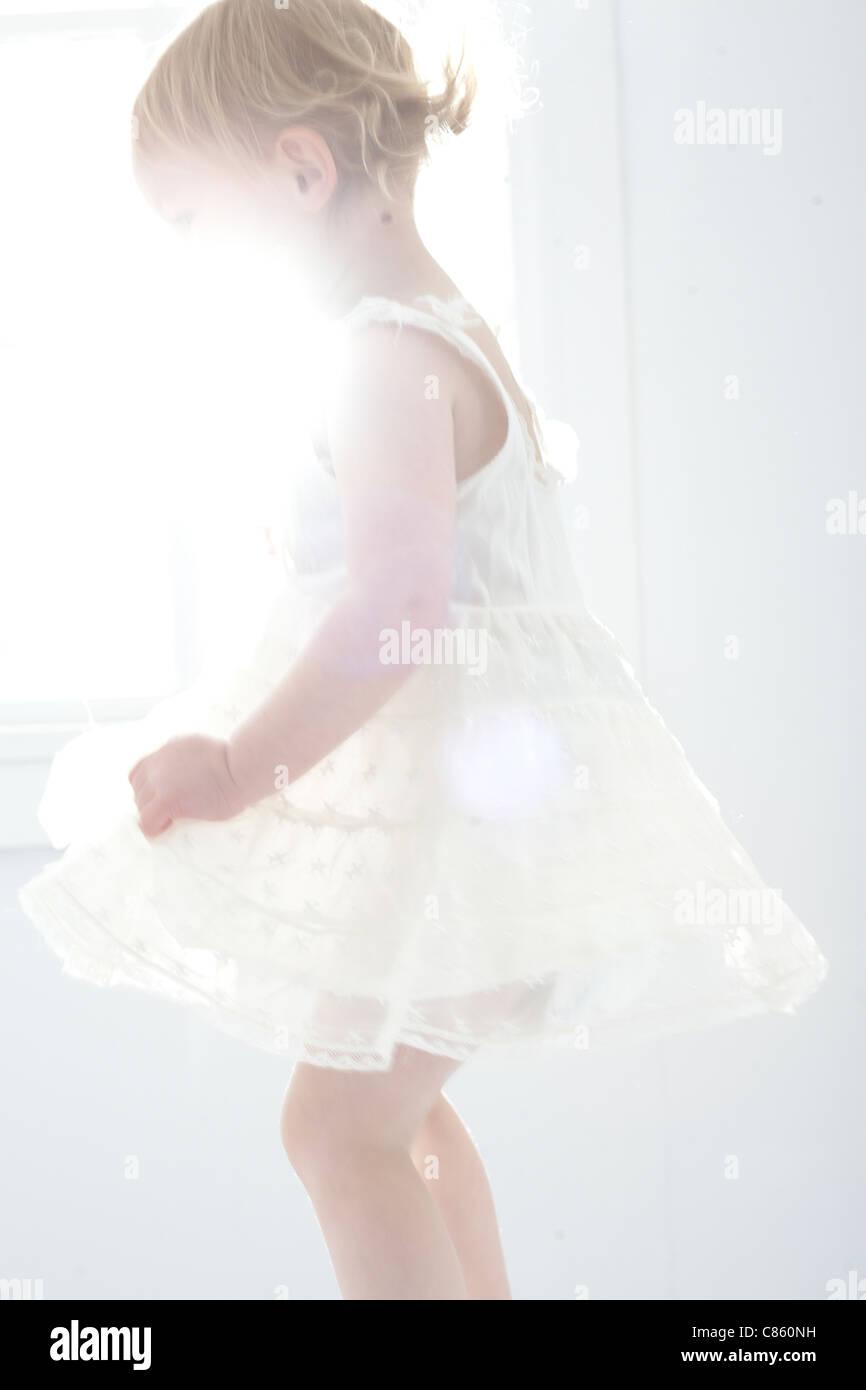 Little girl in white dress - Stock Image