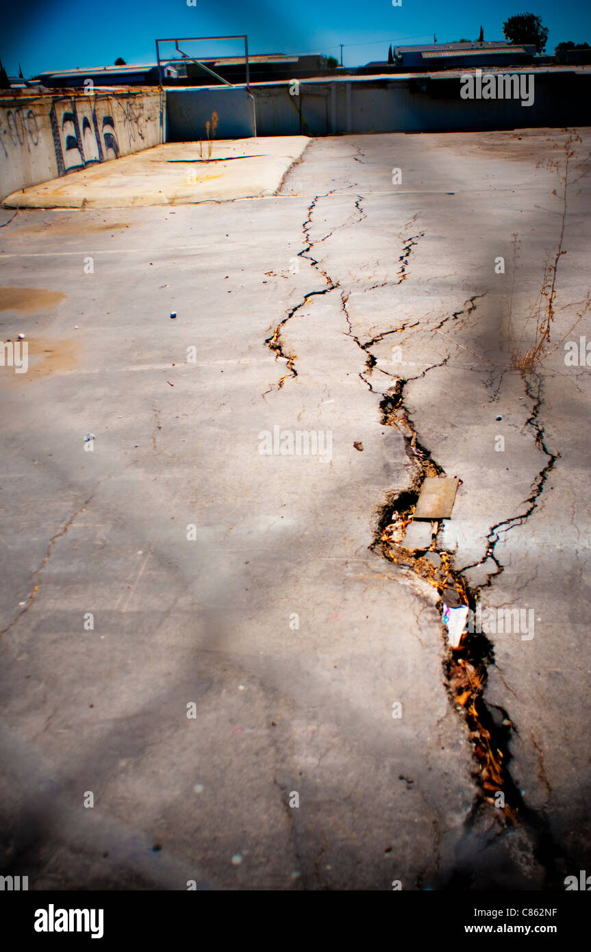 Abandon demolished building foundation crack - Stock Image