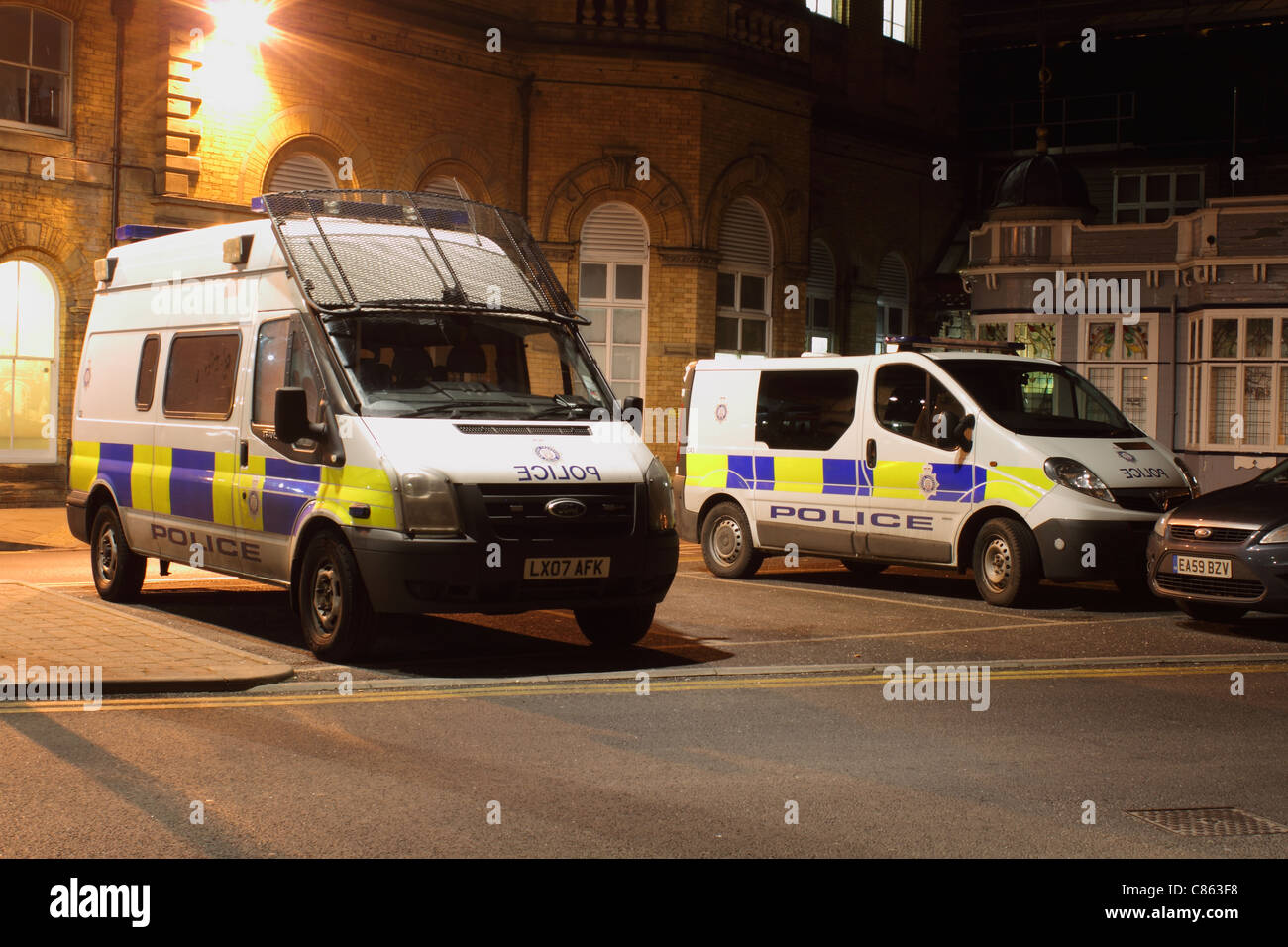 police car uk riot van with wire mesh windscreen guard - Stock Image