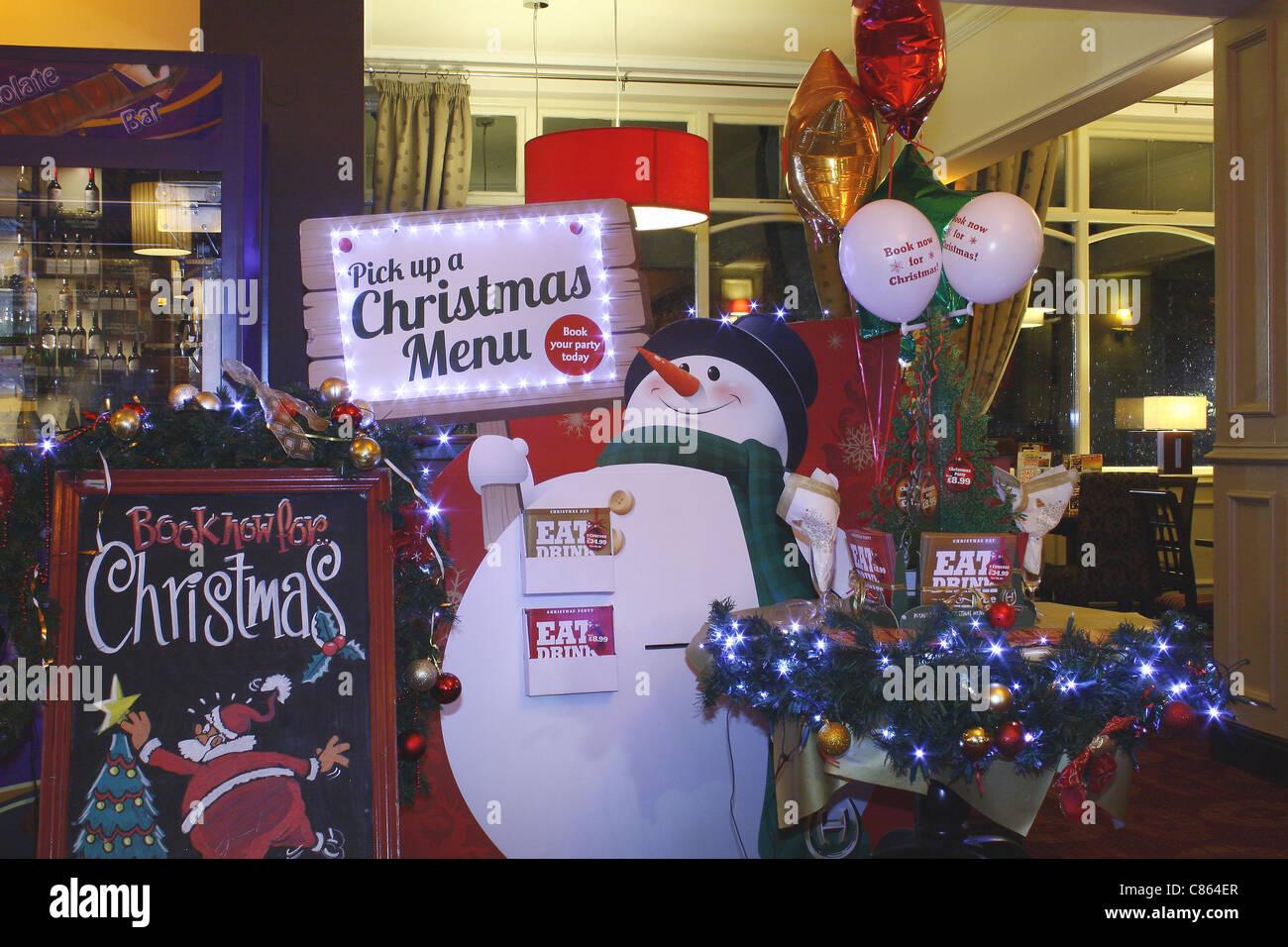 christmas display for menus in local pub - Stock Image