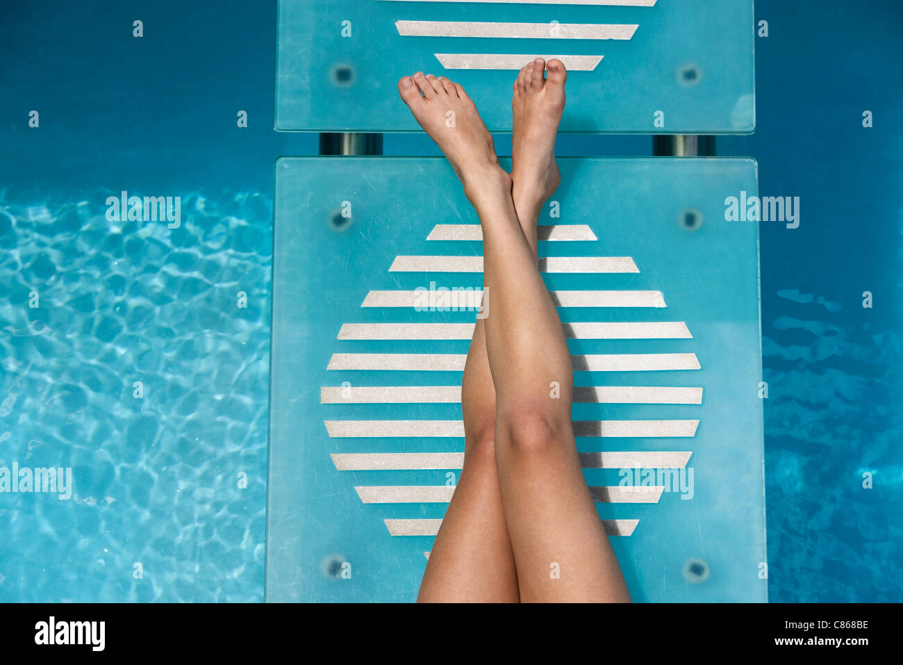 Relaxing poolside - Stock Image