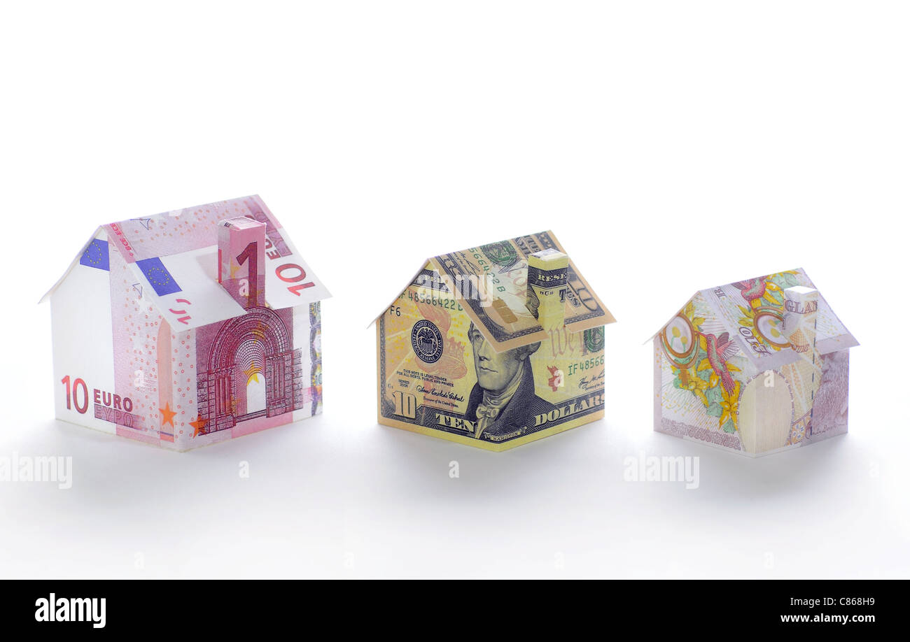 Model houses folded with different currencies - Stock Image