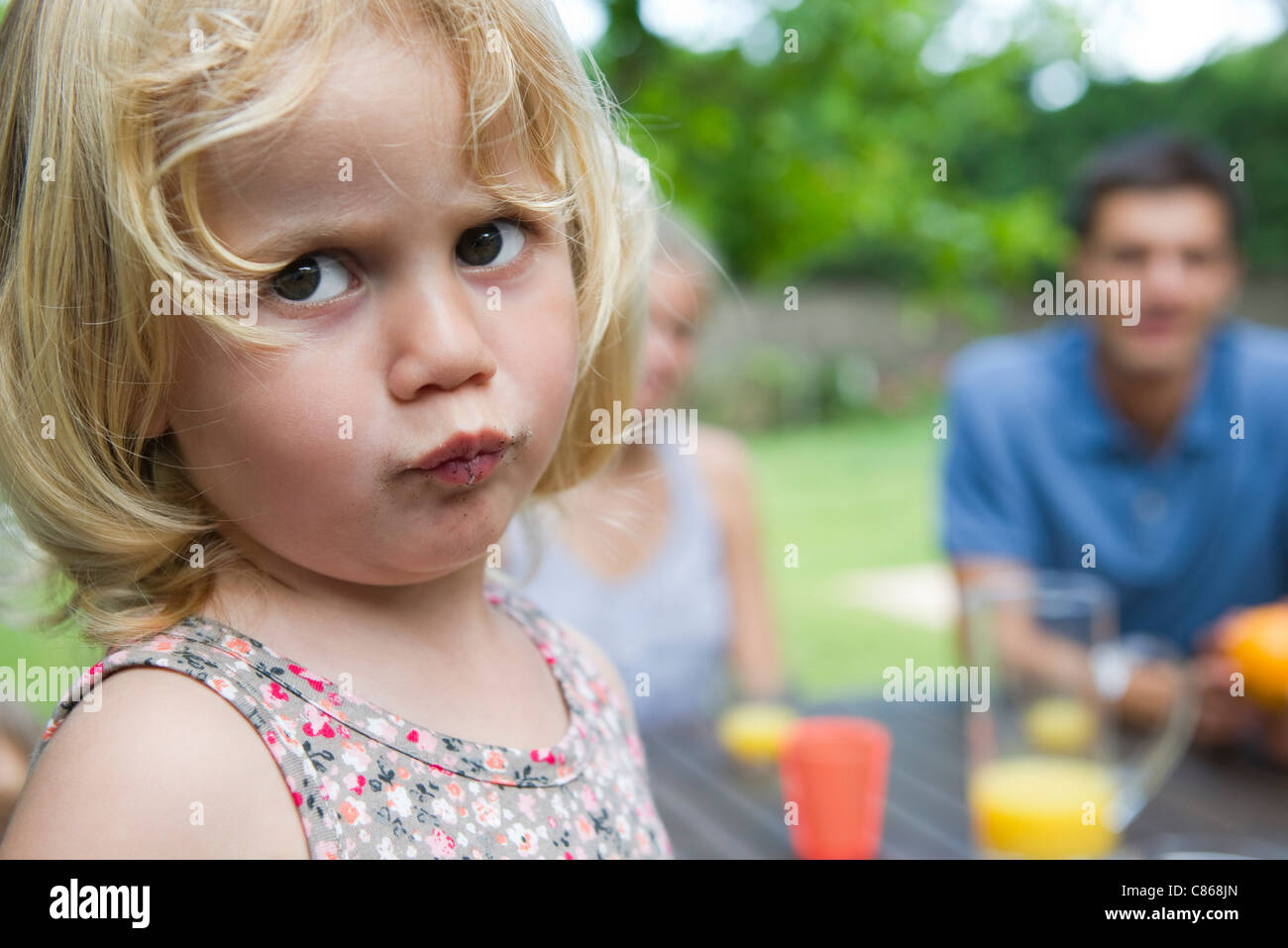 Little girl with messy face - Stock Image