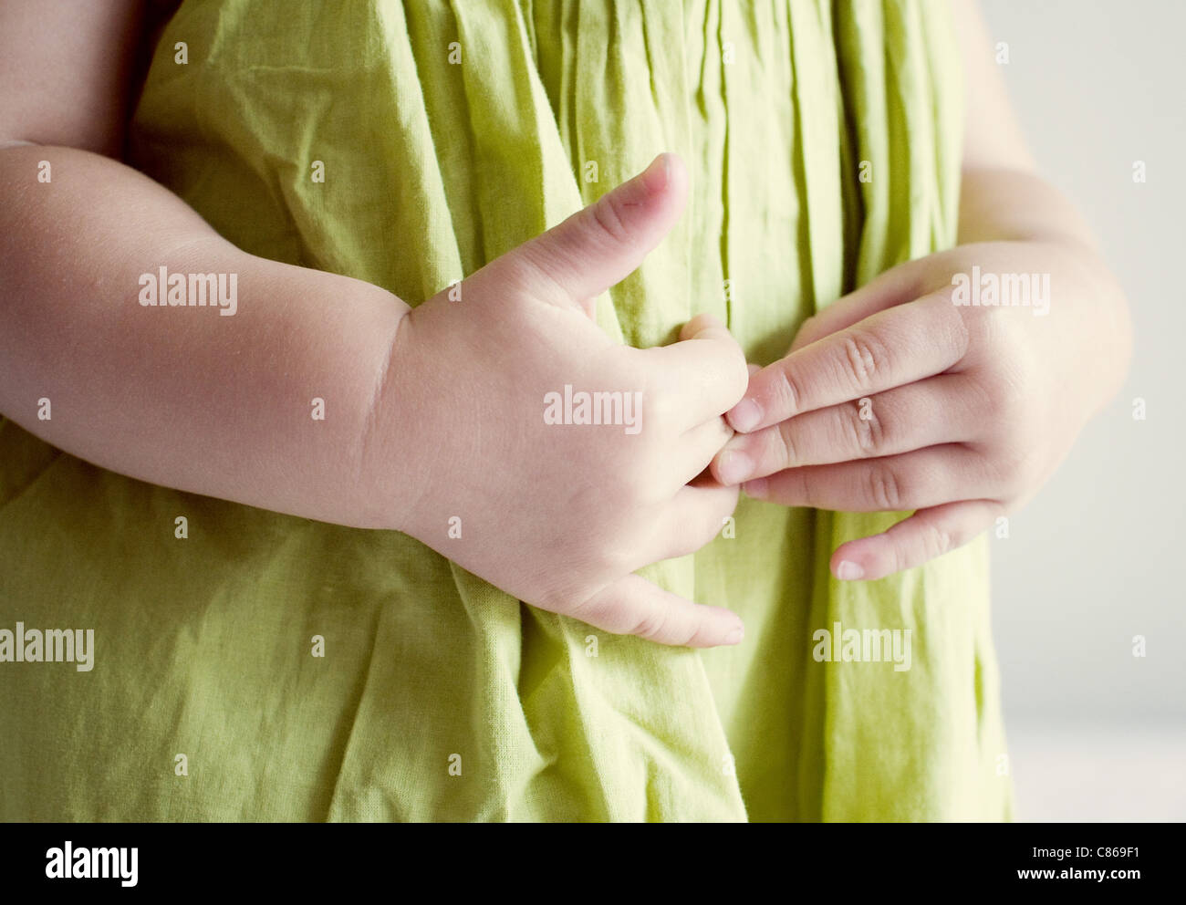 Child putting hands on stomach - Stock Image