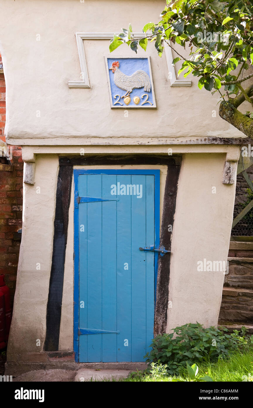A little crooked house. The back door of a remote cottage in Herefordshire, UK - Stock Image