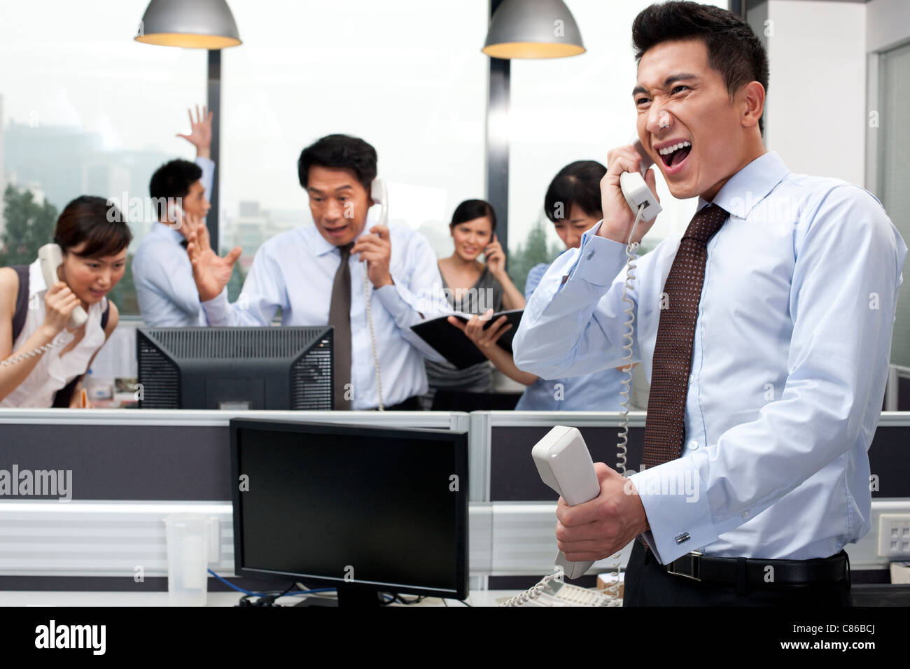 Office Shouting While on Telephone - Stock Image