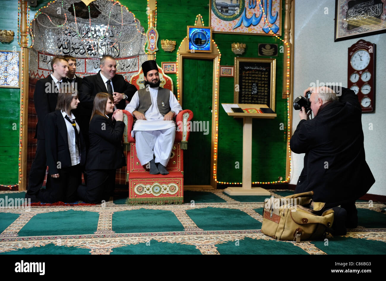 Children from Mitchell High School, Stoke-on-Trent are photographed by the local press with Sheik Hanif at Tunstall - Stock Image