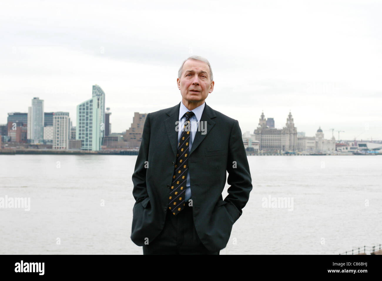 MP Frank Field stands in his constituency, Birkenhead, overlooking the Mersey River and Liverpool Stock Photo
