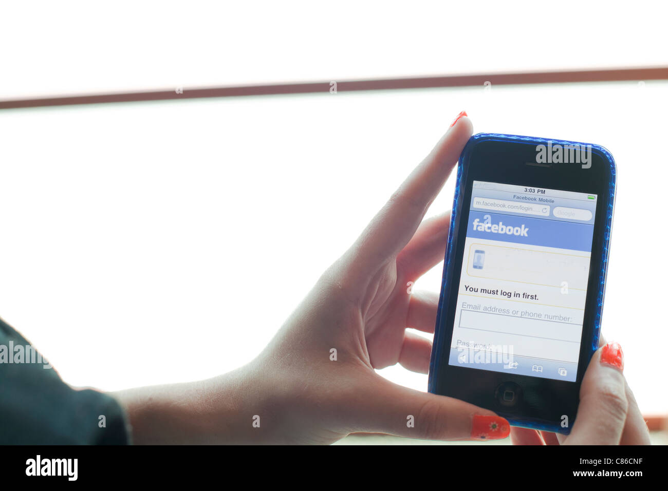 close up of smart phone with facebook on the page - Stock Image