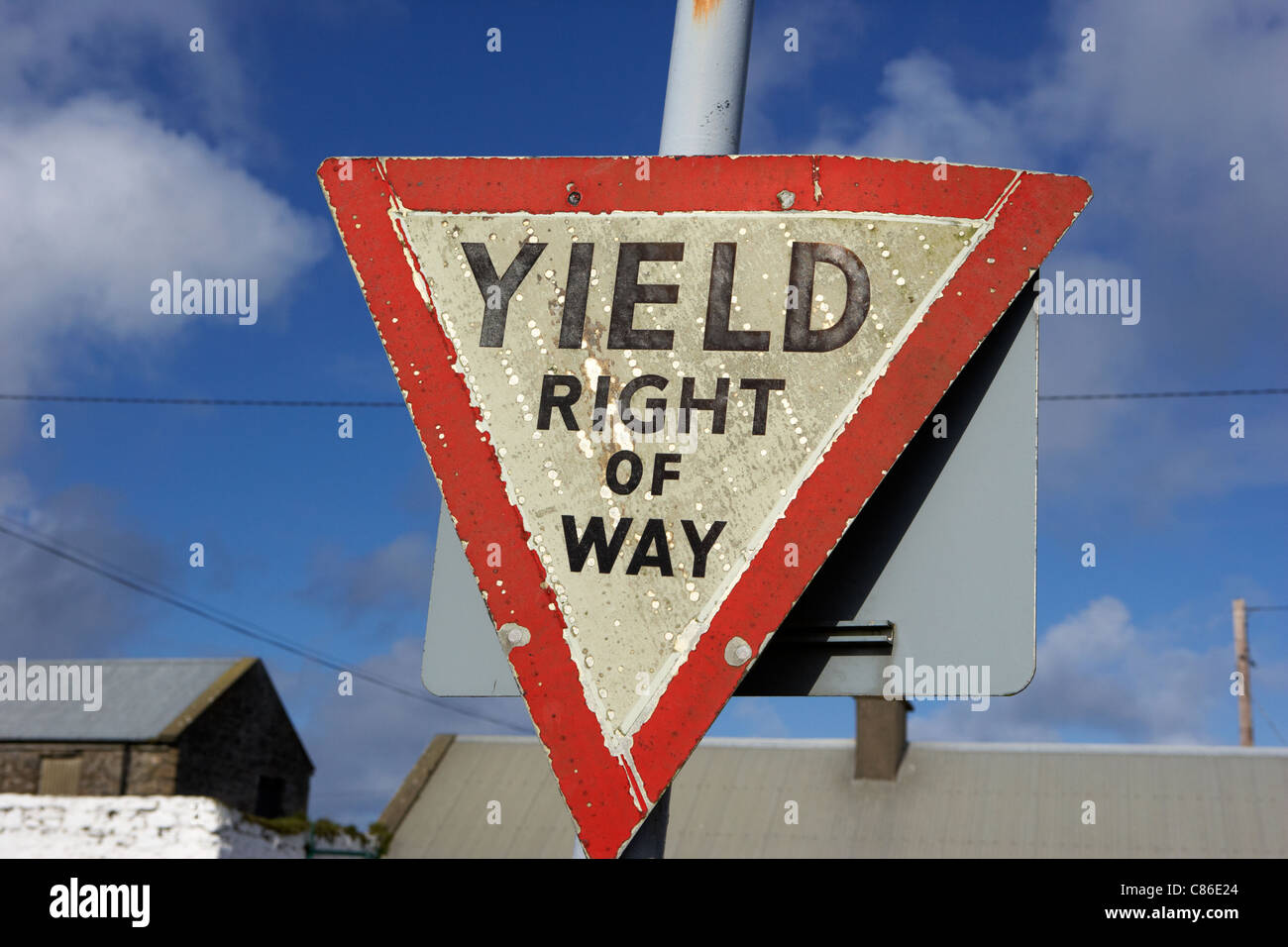 old irish red triangle yield right of way sign in rural ireland - Stock Image