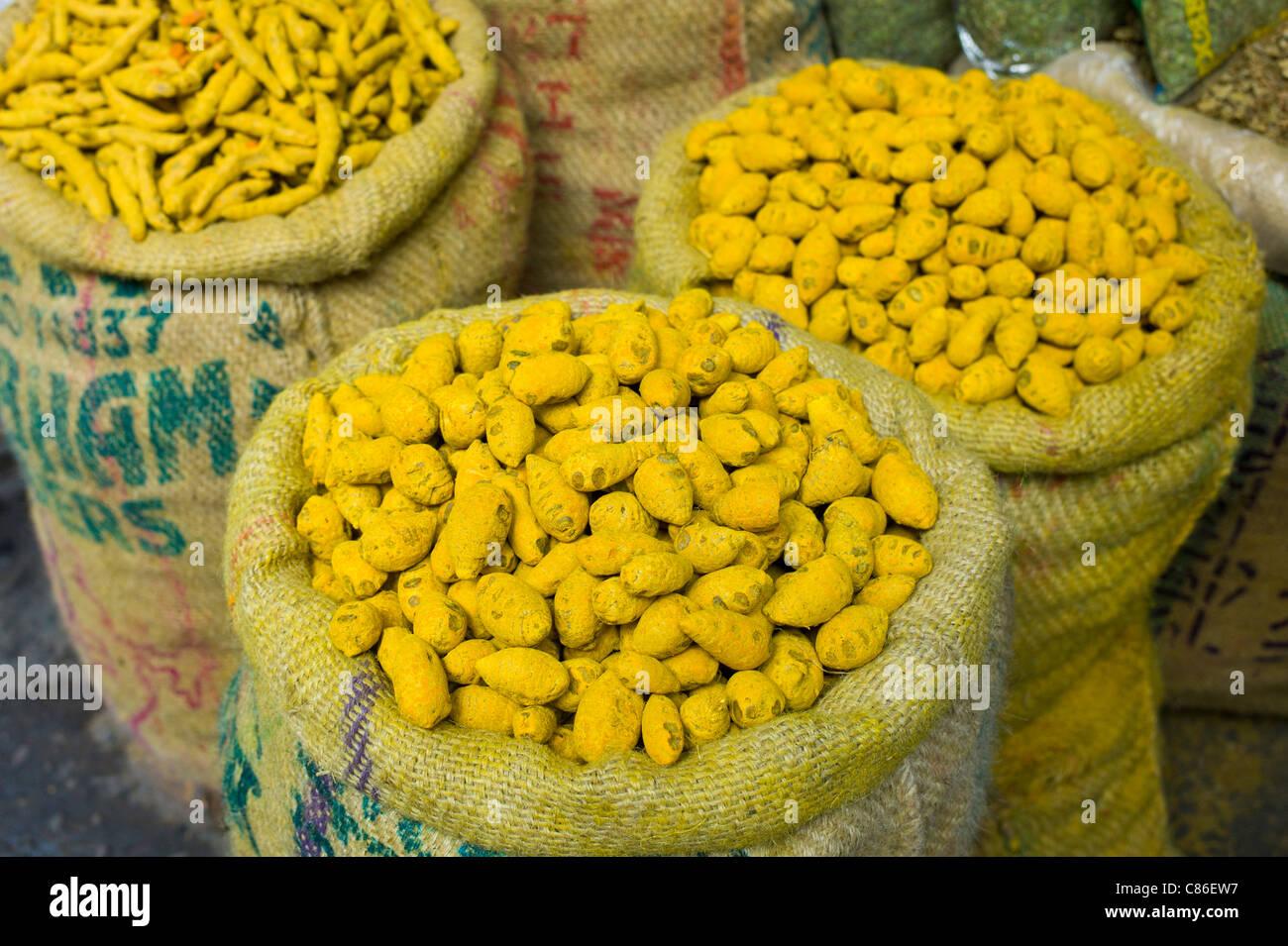 Yellow turmeric on sale at Khari Baoli spice and dried foods market, Old Delhi, India - Stock Image