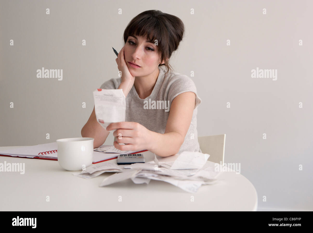 Woman reviewing receipts - Stock Image
