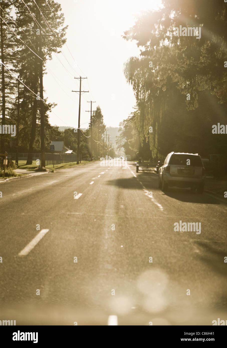 Cars parked on suburban street - Stock Image