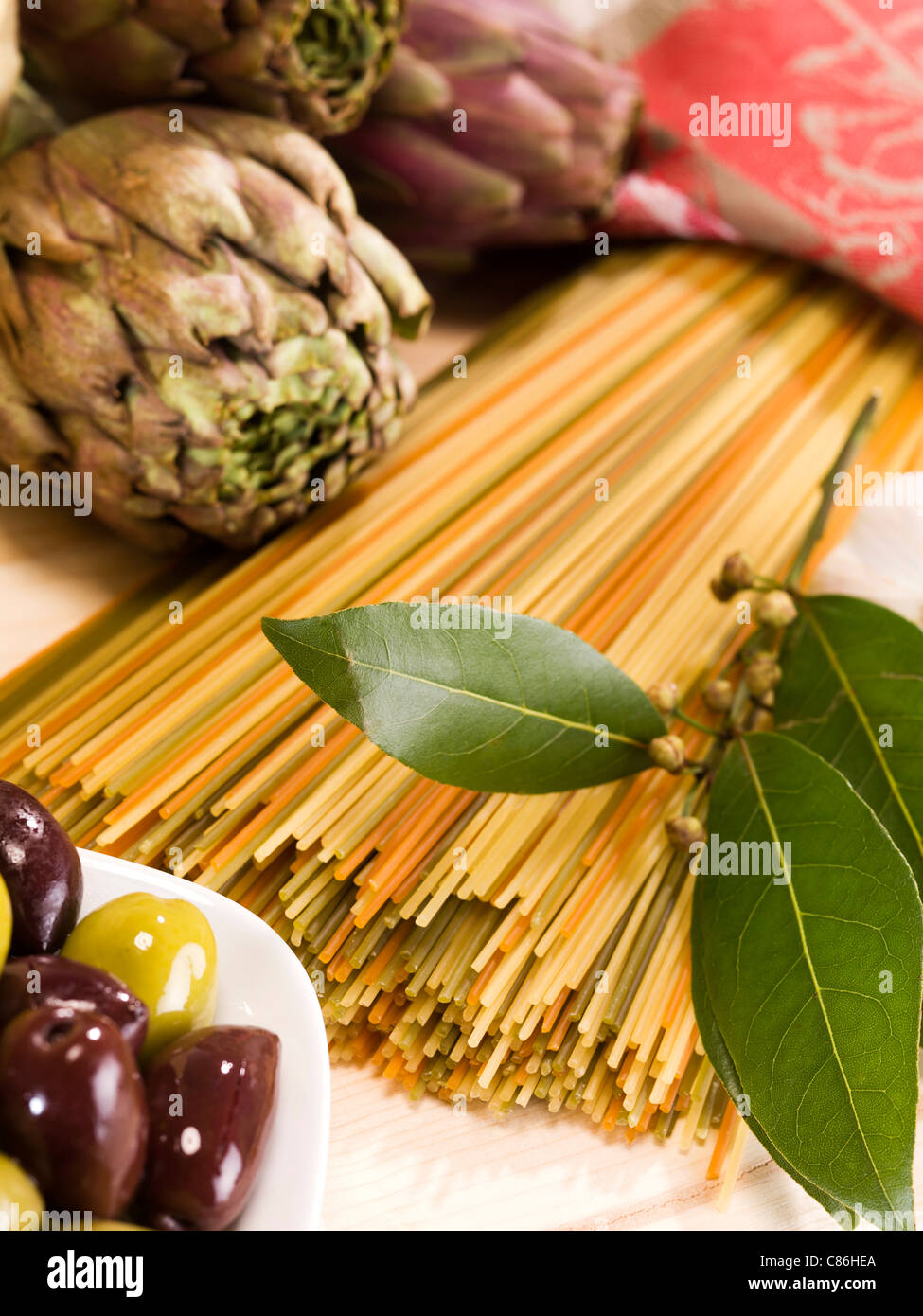 Close up of artichokes, pasta and olives Stock Photo