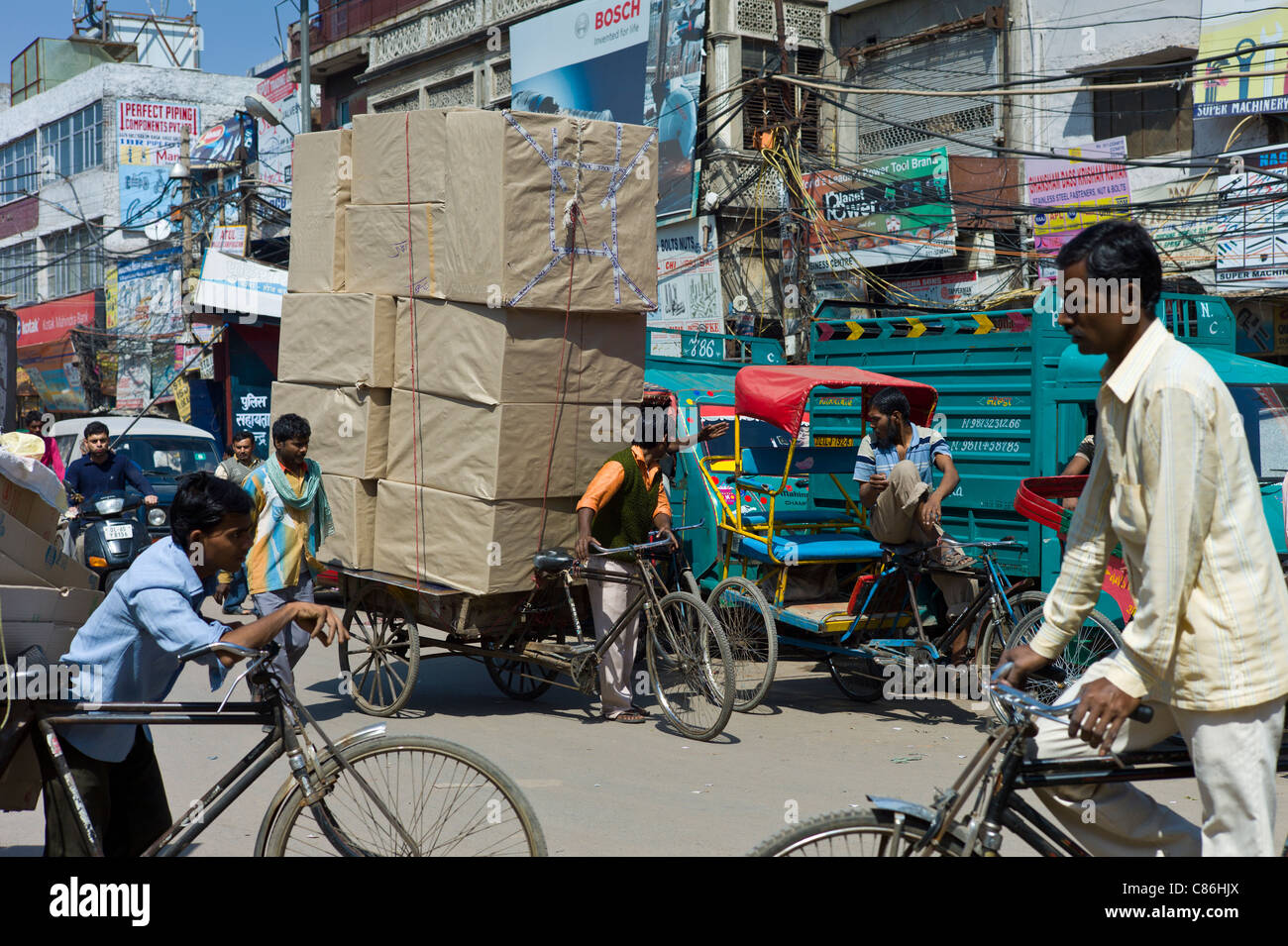 Crowded street scene at Chawri Bazar in Old Delhi, India - Stock Image