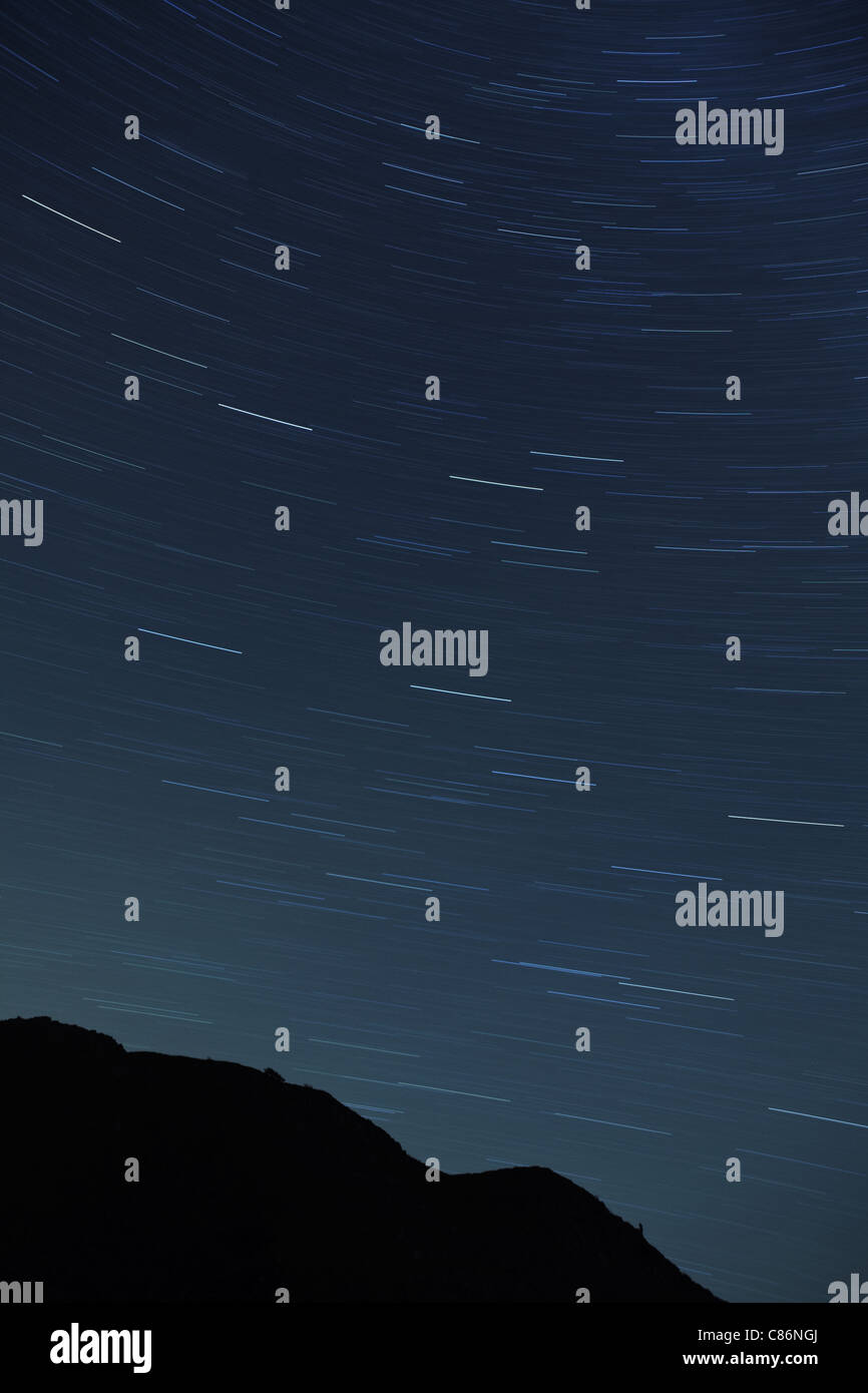 Long exposure of night sky over Eskdale, Cumbria, UK - Stock Image