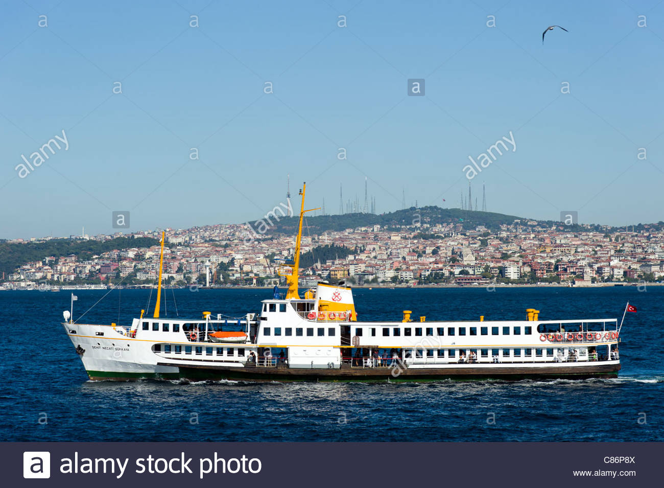 Ferry on the Bosphorus with the Asia side behind, Istanbul, Turkey - Stock Image