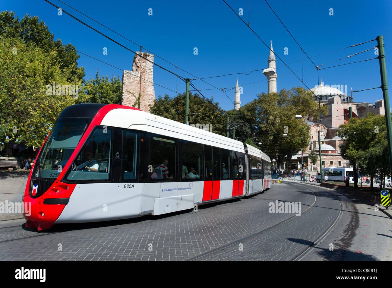 Modern tram passing through Sultanahmet, Istanbul, Turkey - Stock Image