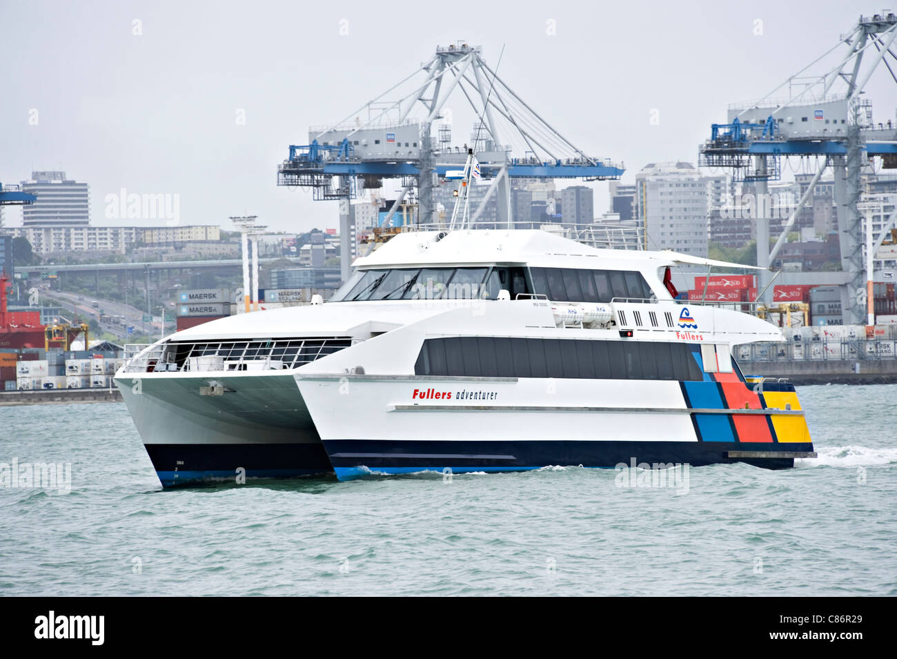 The Ferry and Tourist Catamaran Fullers Adventurer Cruising in Auckland Harbour North Island New Zealand NZ - Stock Image